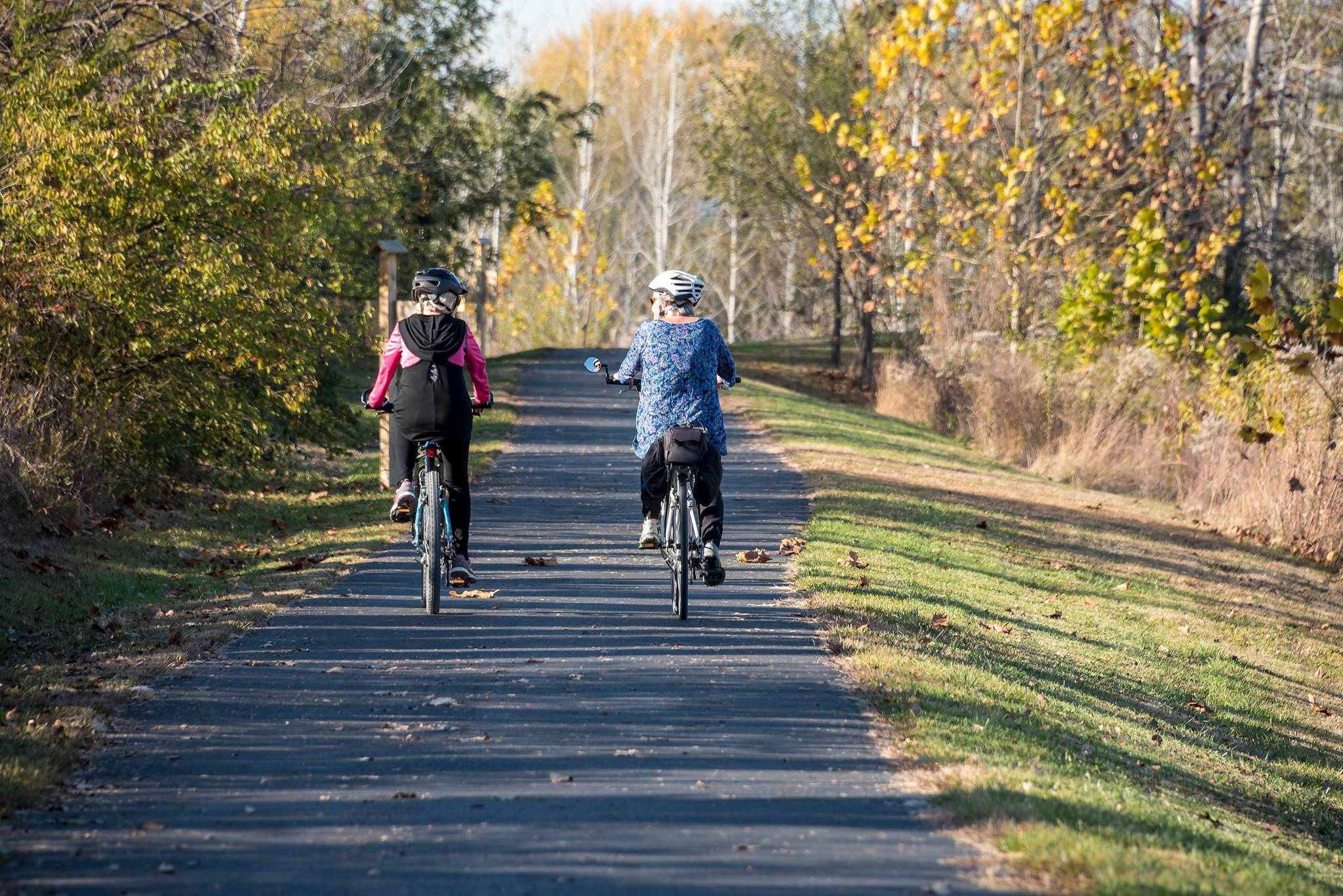 Two Cyclists on the Greenway
